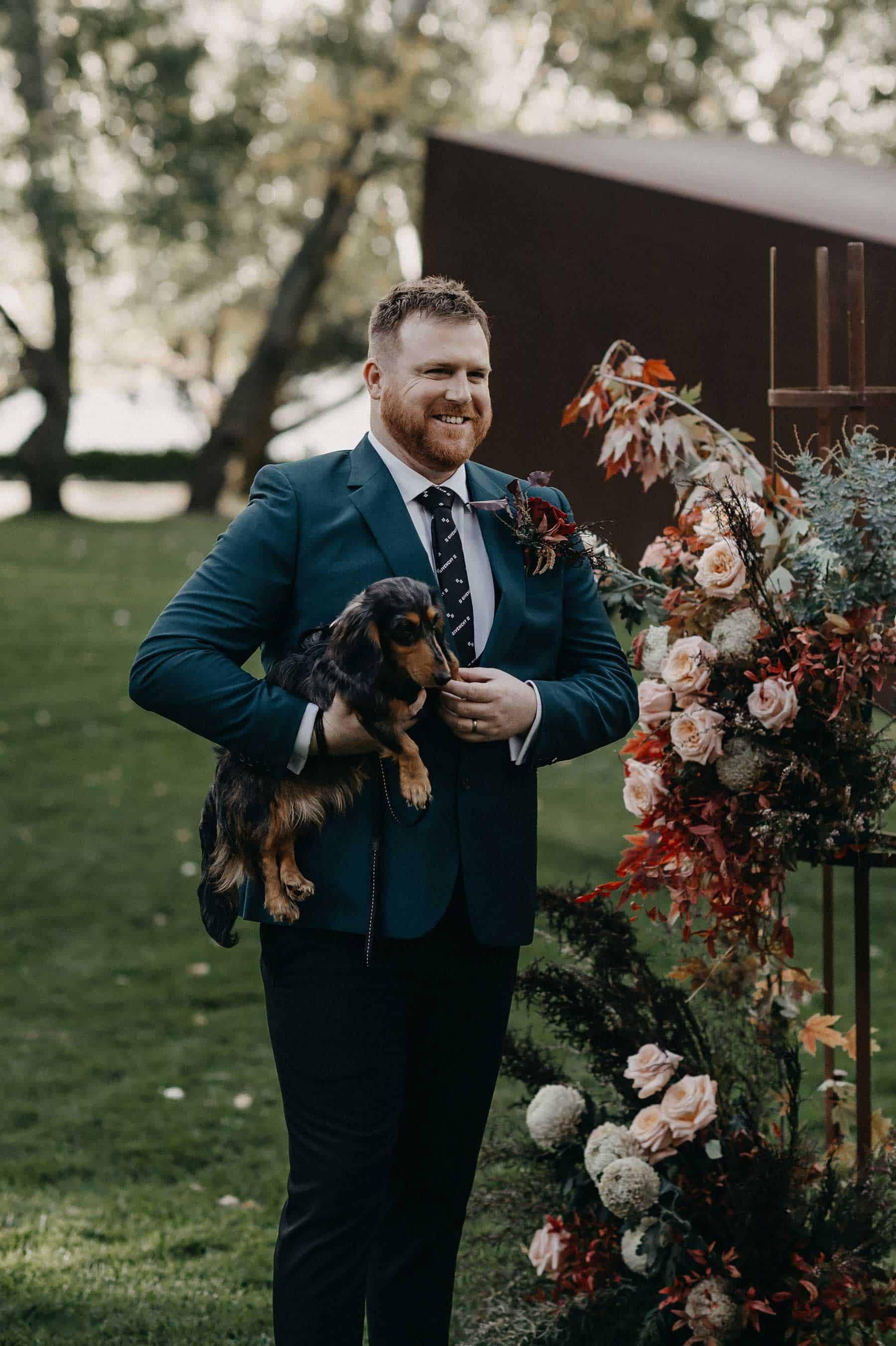 groom with daschund