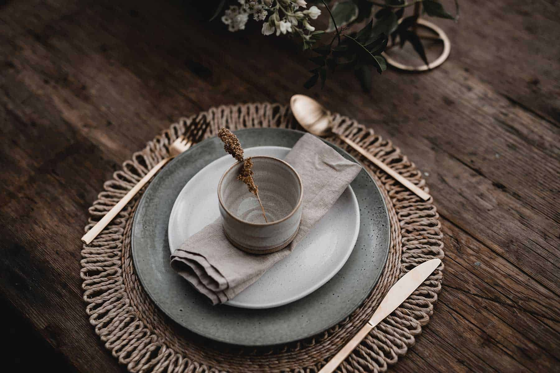 earthy table setting with gold cutlery