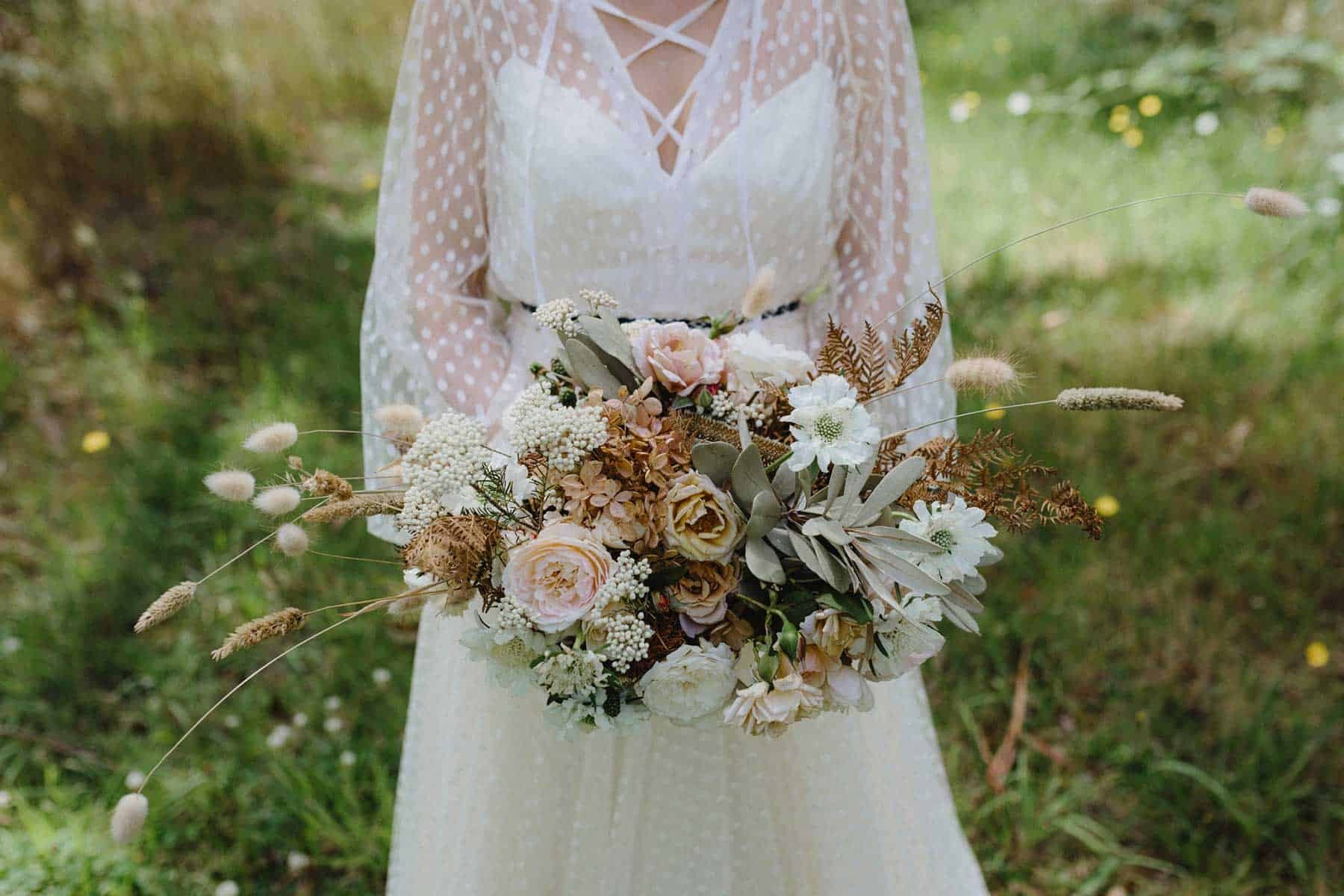 unstructured bridal bouquet with foraged grasses