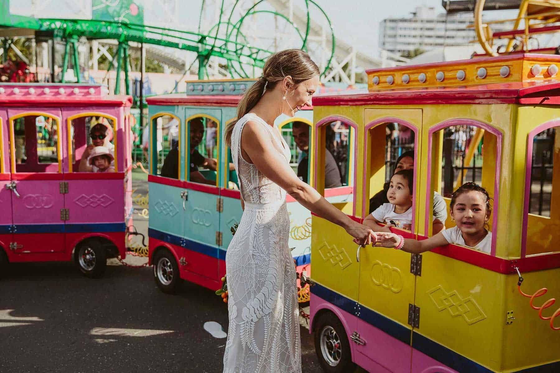 fun modern wedding at Luna Park, St Kilda Melbourne