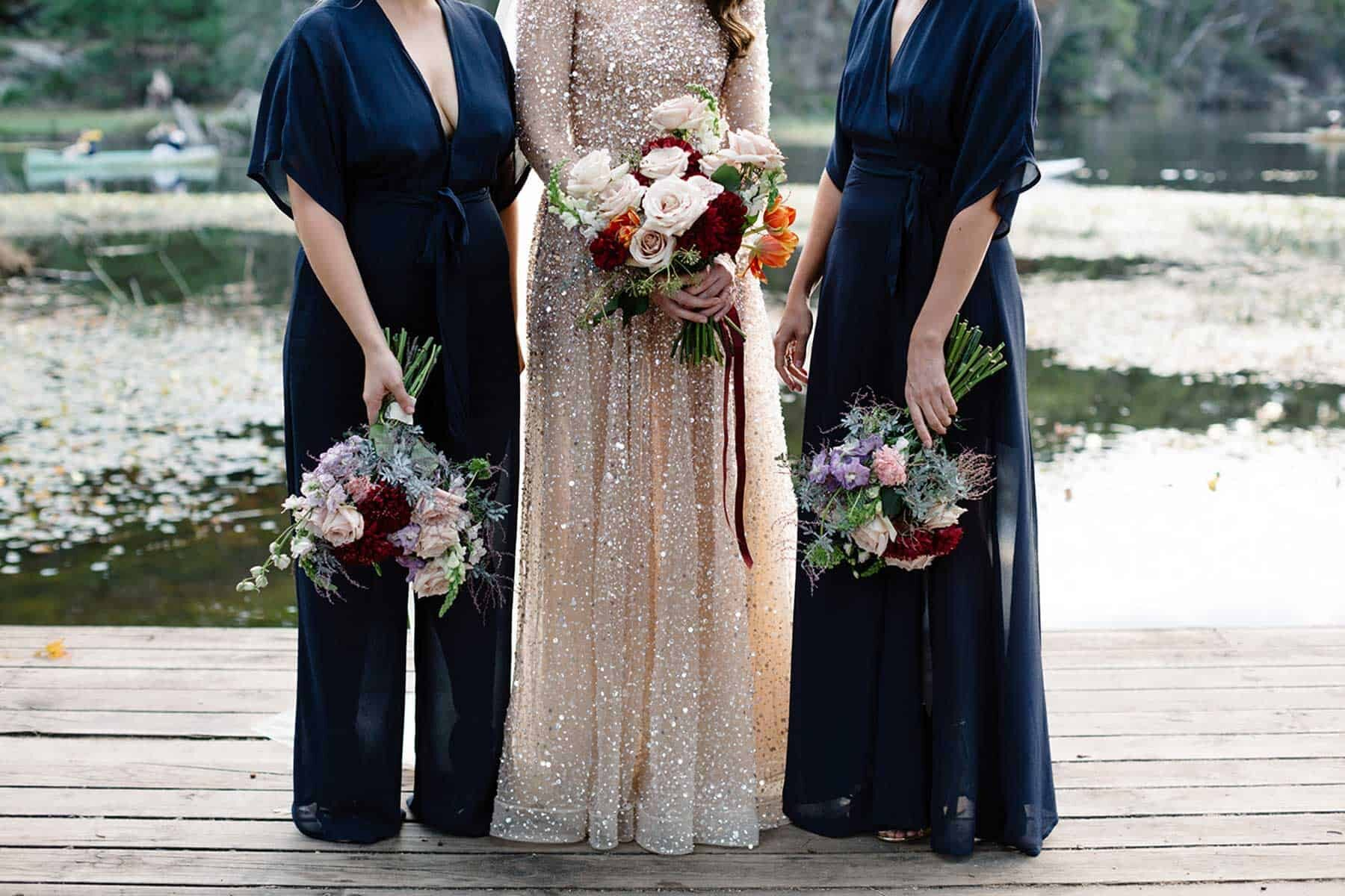long navy bridesmaid dress and jumpsuit from Reformation