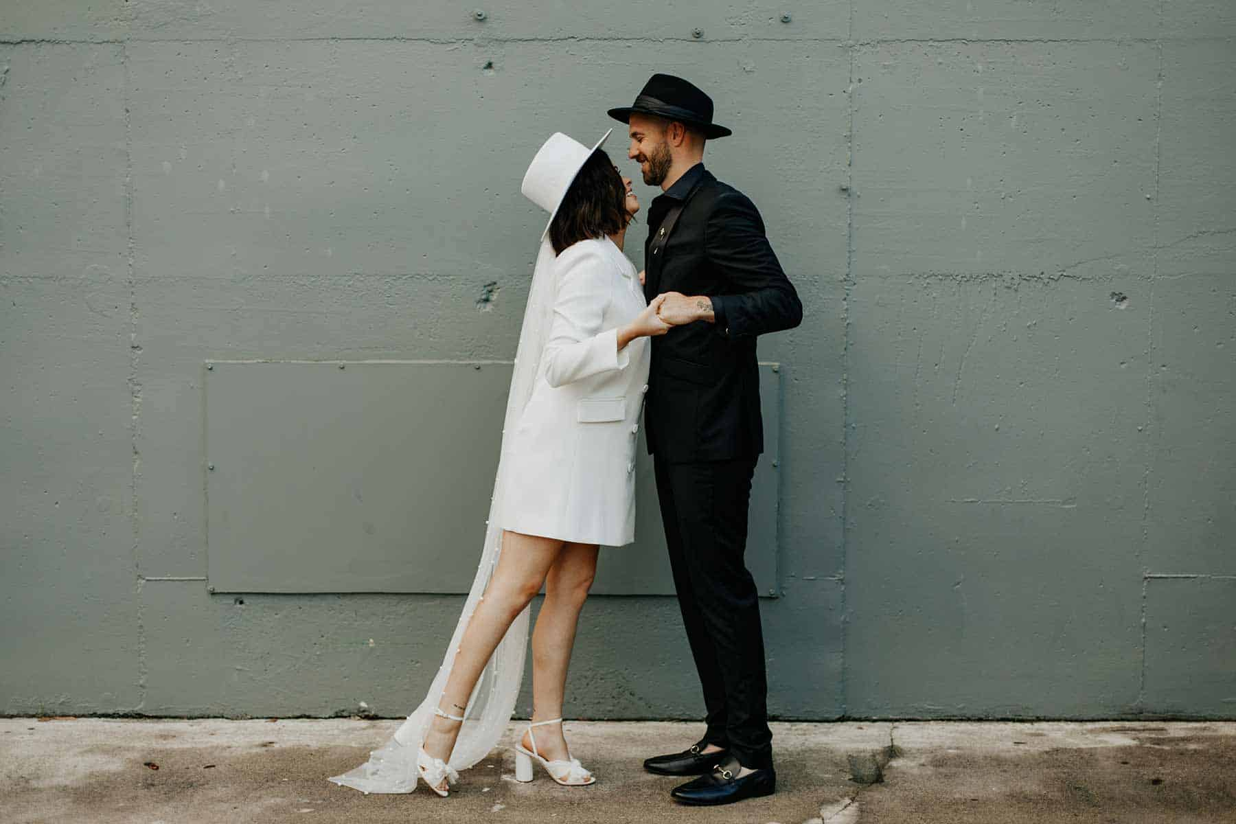 modern bride and groom in fedora hats