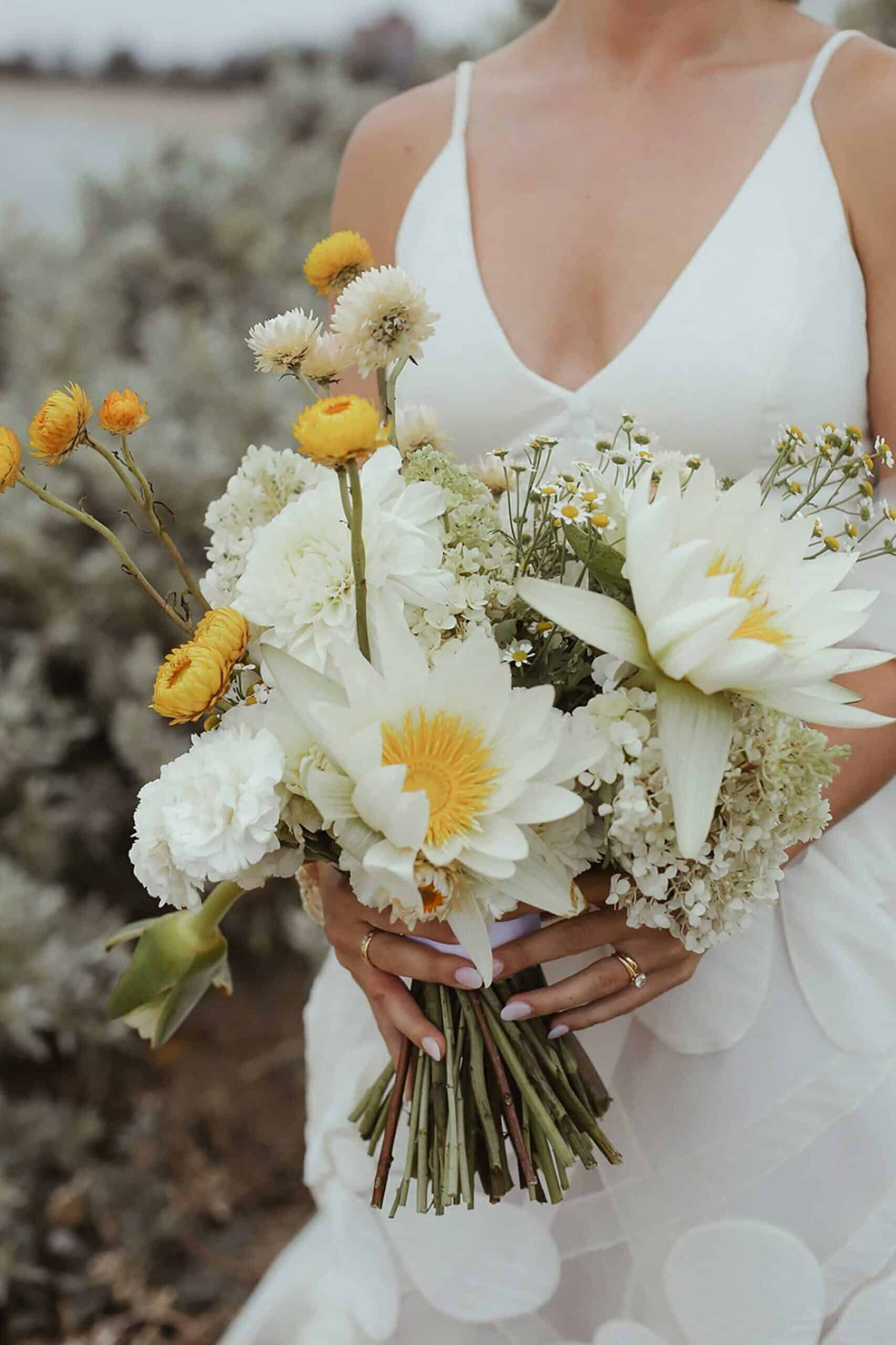 white and yellow bridal bouquet with lilies