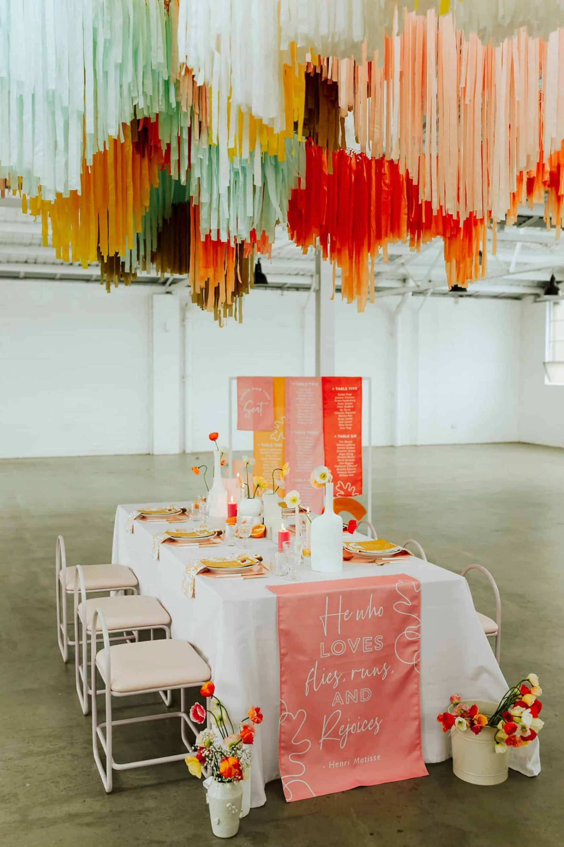 warehouse wedding with colourful hanging streamer installation