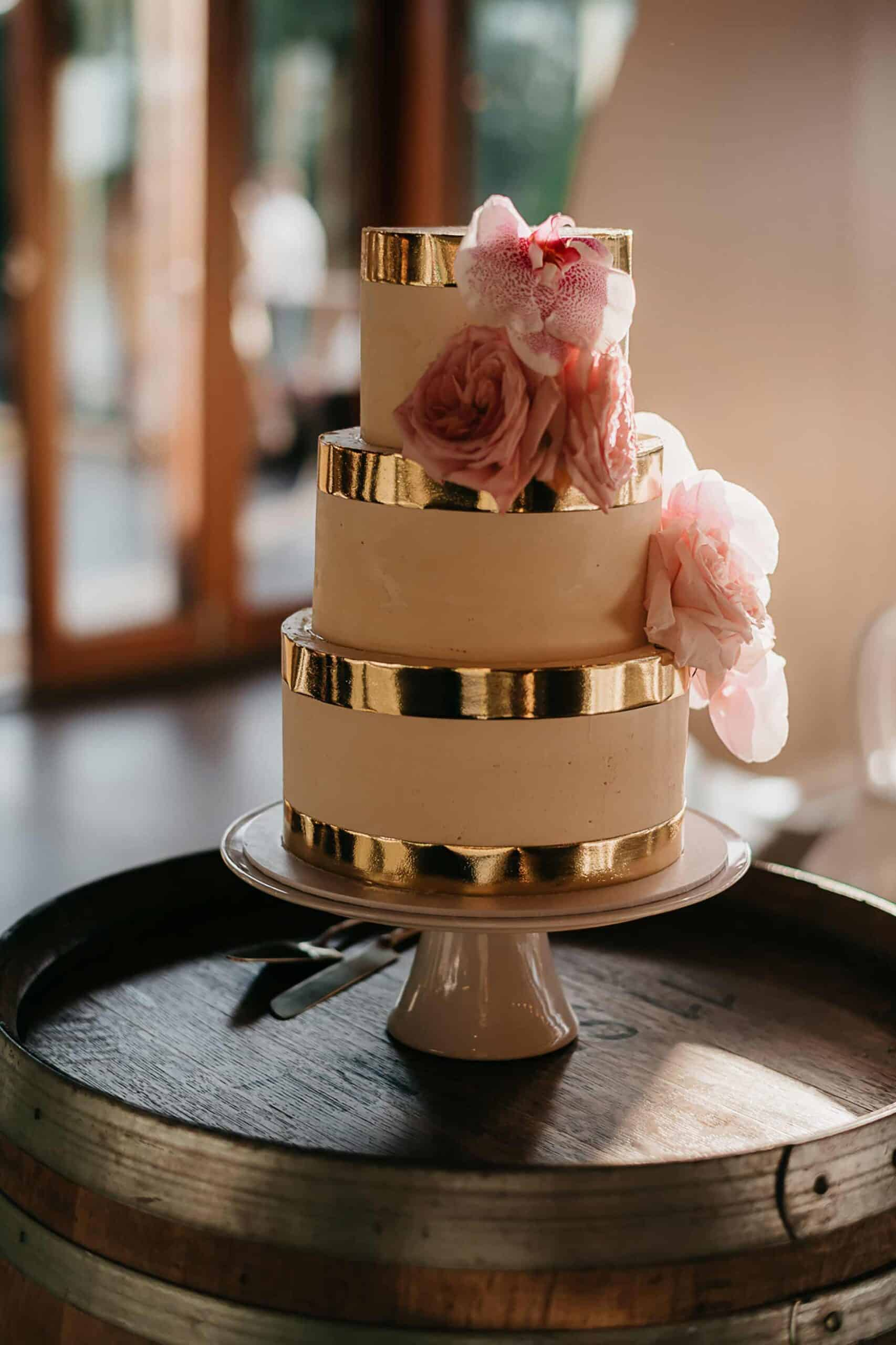 modern three tier wedding cake with gold trim