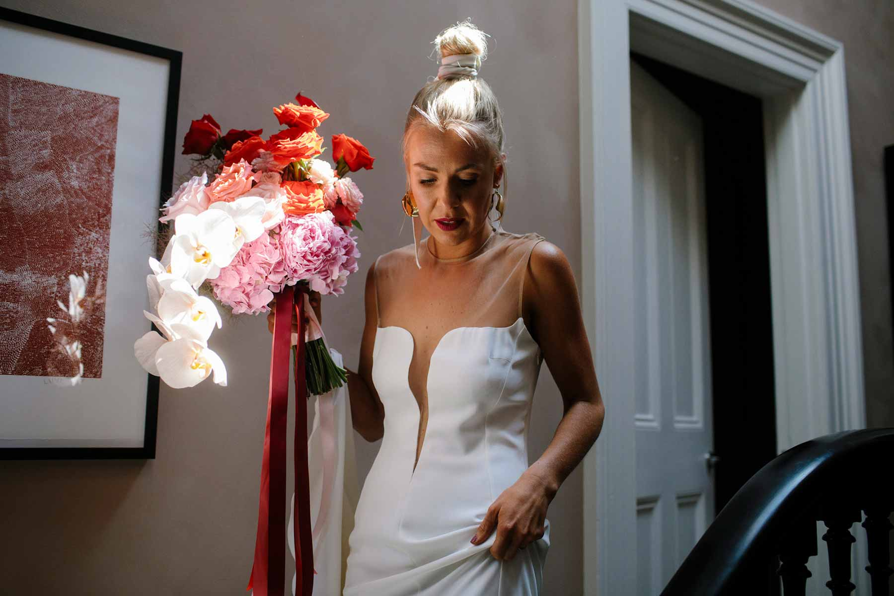 unstructured pink and red bridal bouquet with Chinese orchids