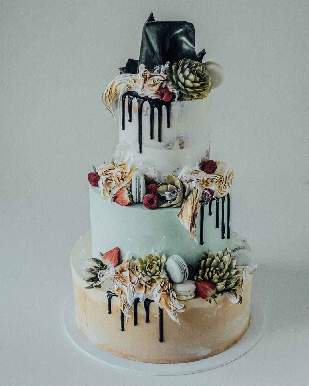 Fun modern wedding cake with macarons and chocolate drip